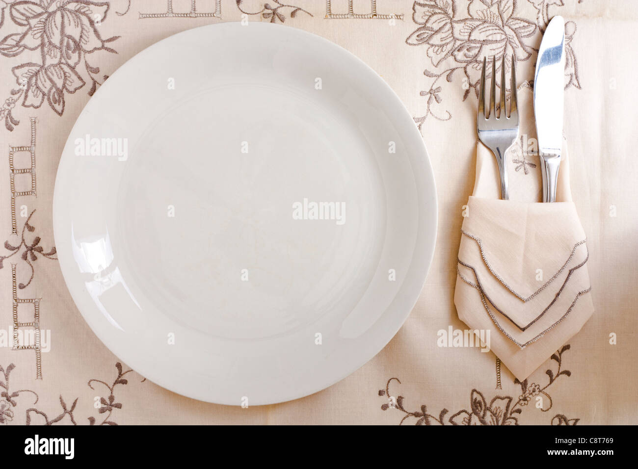 Empty Dish with Silverware - Stock Image