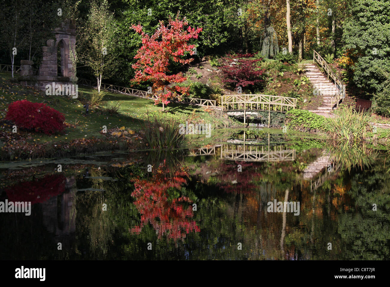 Cholmondeley Castle Gardens. Autumnal view the Duckery Ruin Water ...