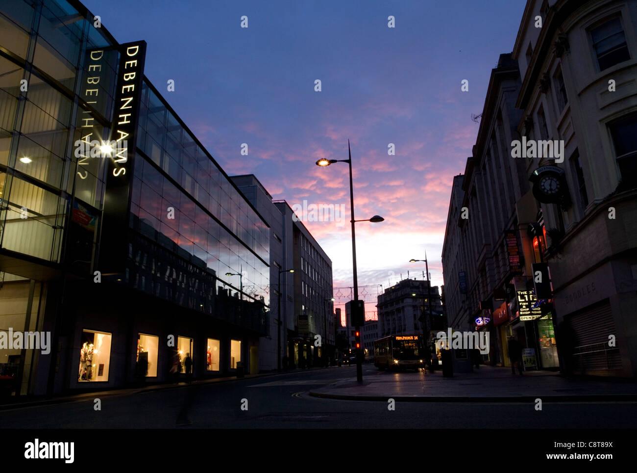 Manchester centre shops at dusk - Stock Image