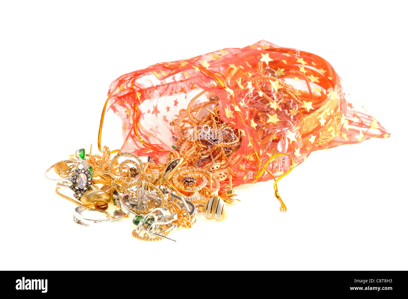 Full red bag of a gold jewelry on a white background - Stock Image