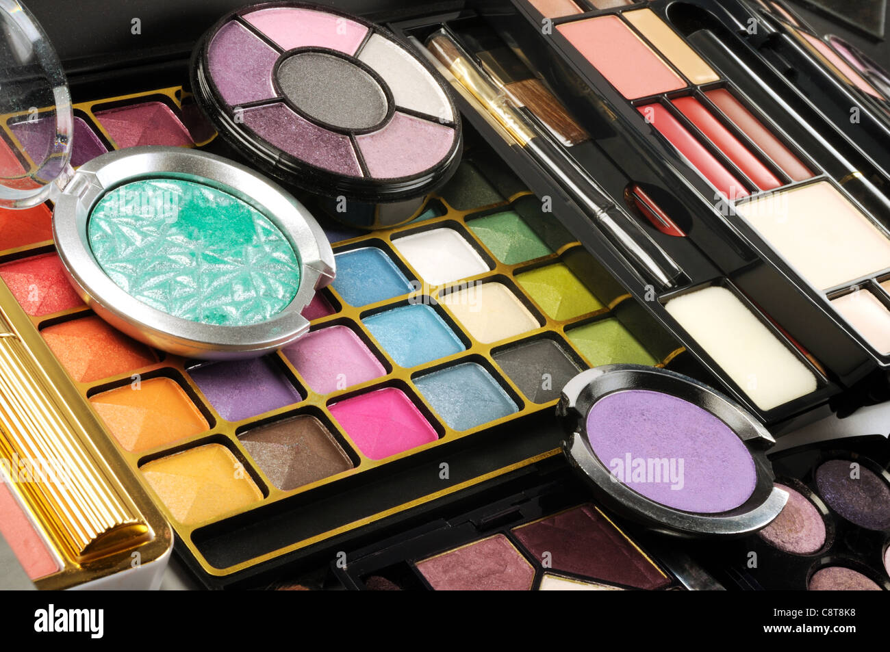 Lot of decorative colorful makeup sets , close up shot - Stock Image