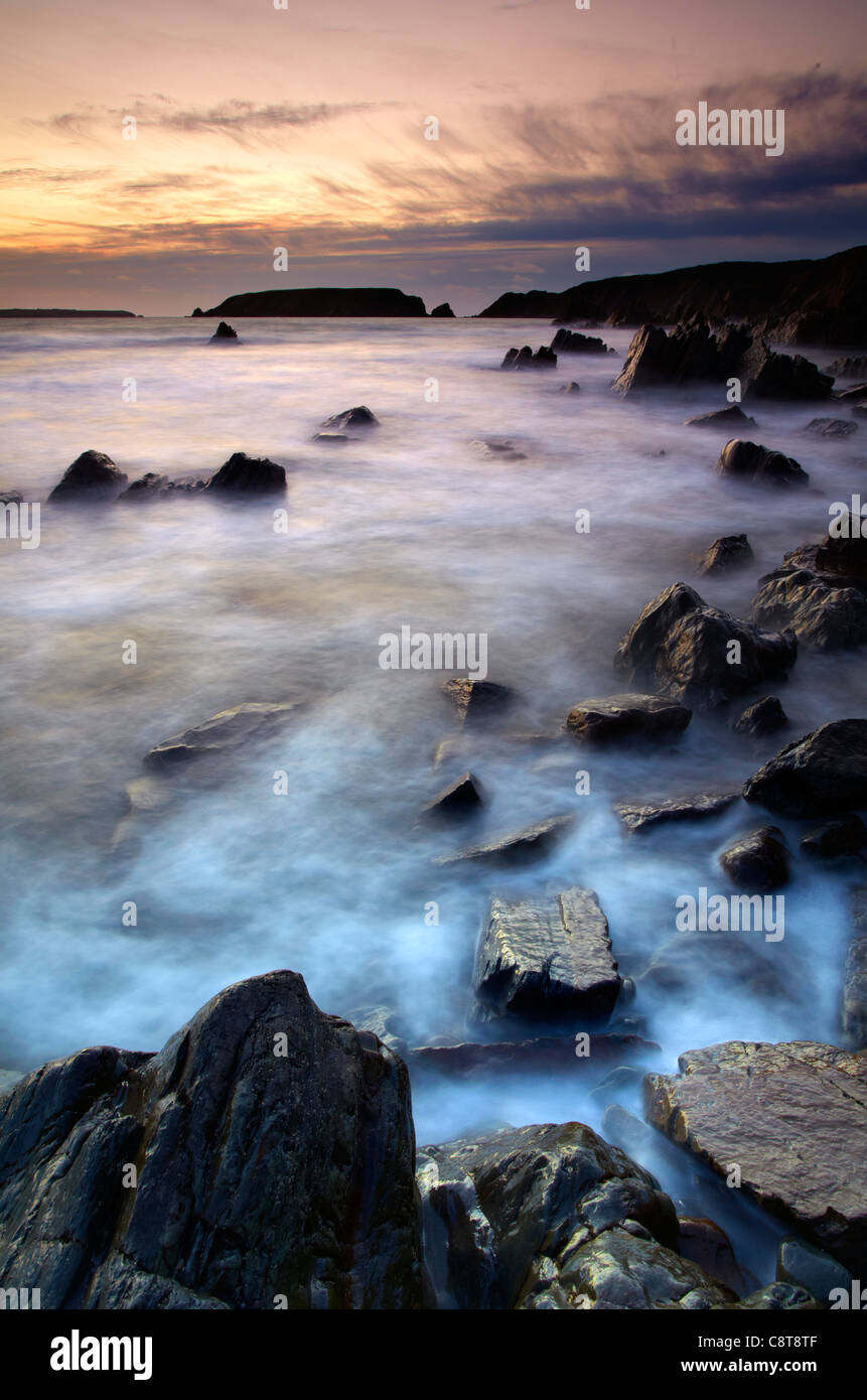 Marloes sands looking towards Gateholm Island and Skokholm Island, dusk. - Stock Image