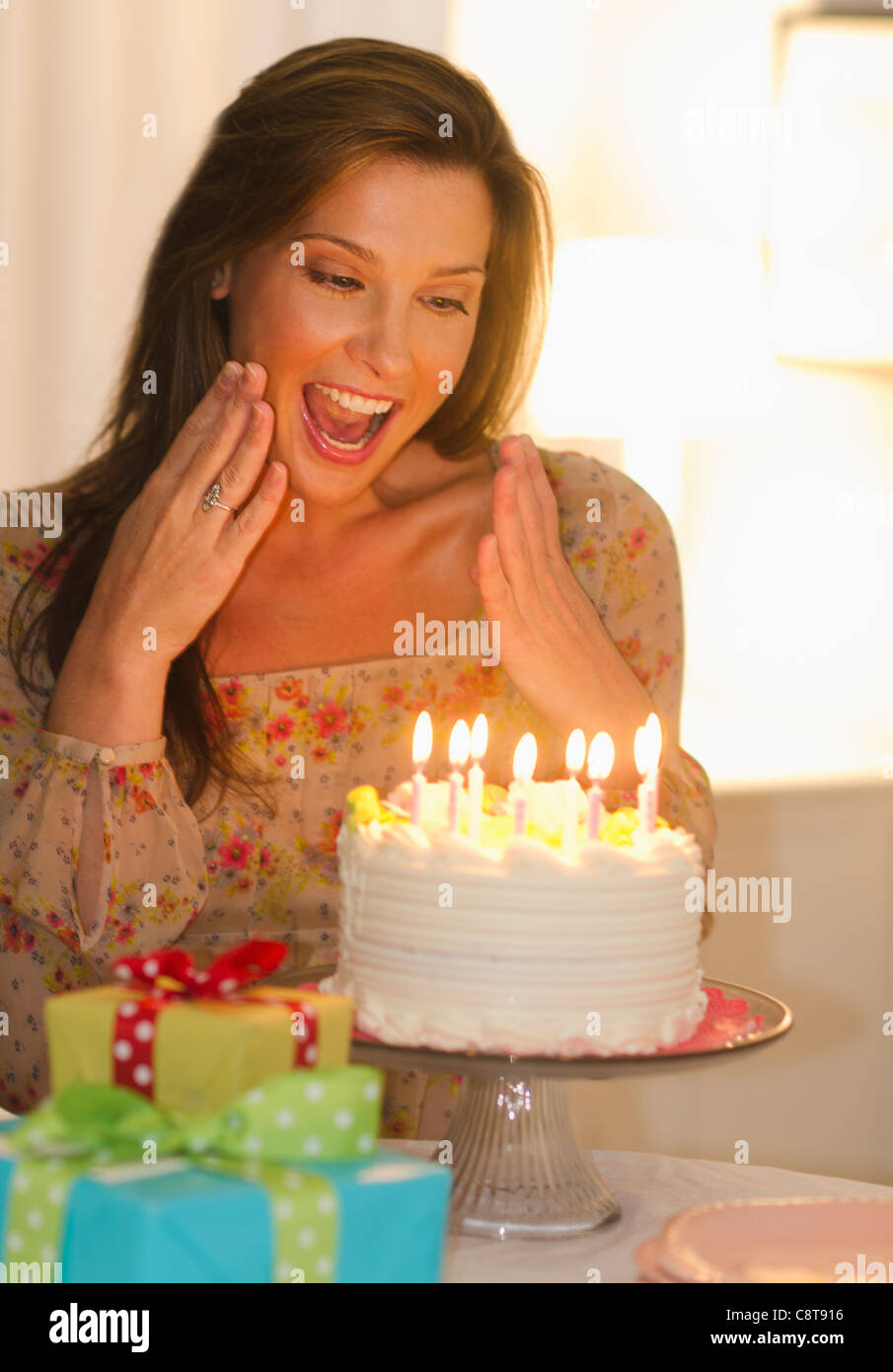 USA New Jersey City Woman Looking At Birthday Cake