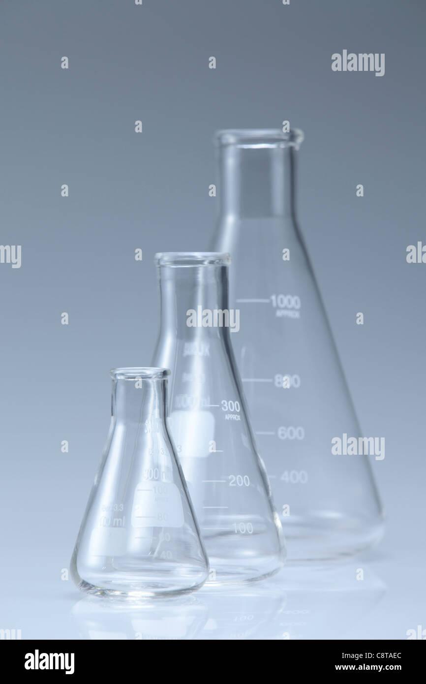 Three Glass Beakers With White Background - Stock Image