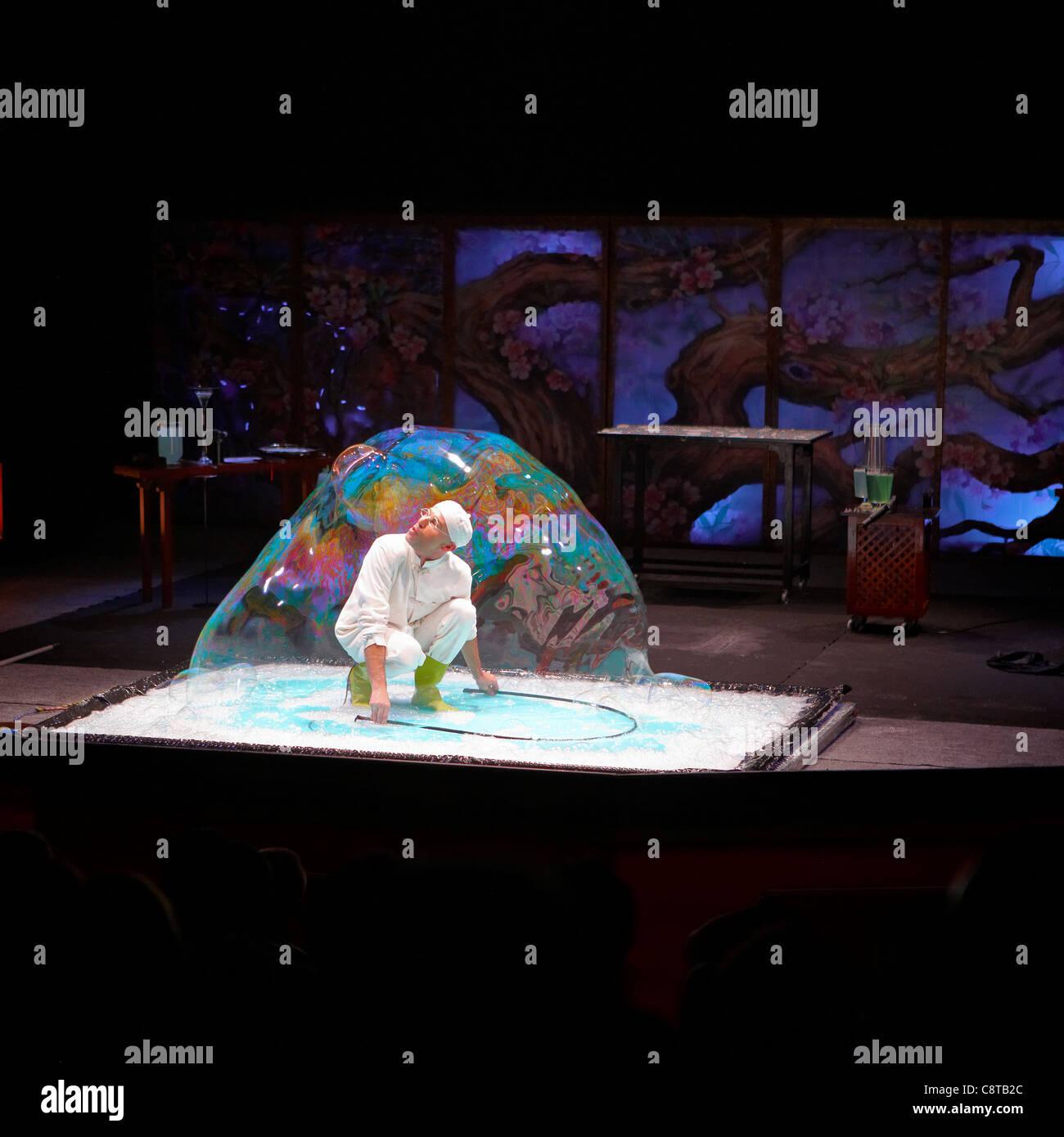 Man inside soap bubble.Port Aventura amusement park, Salou, Catalonia, Spain. - Stock Image