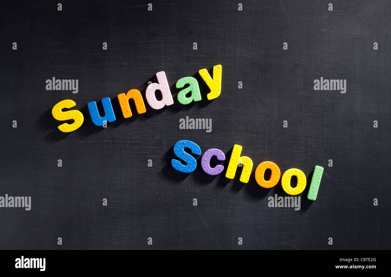 Sunday School' in multi colored alphabets - Stock Image