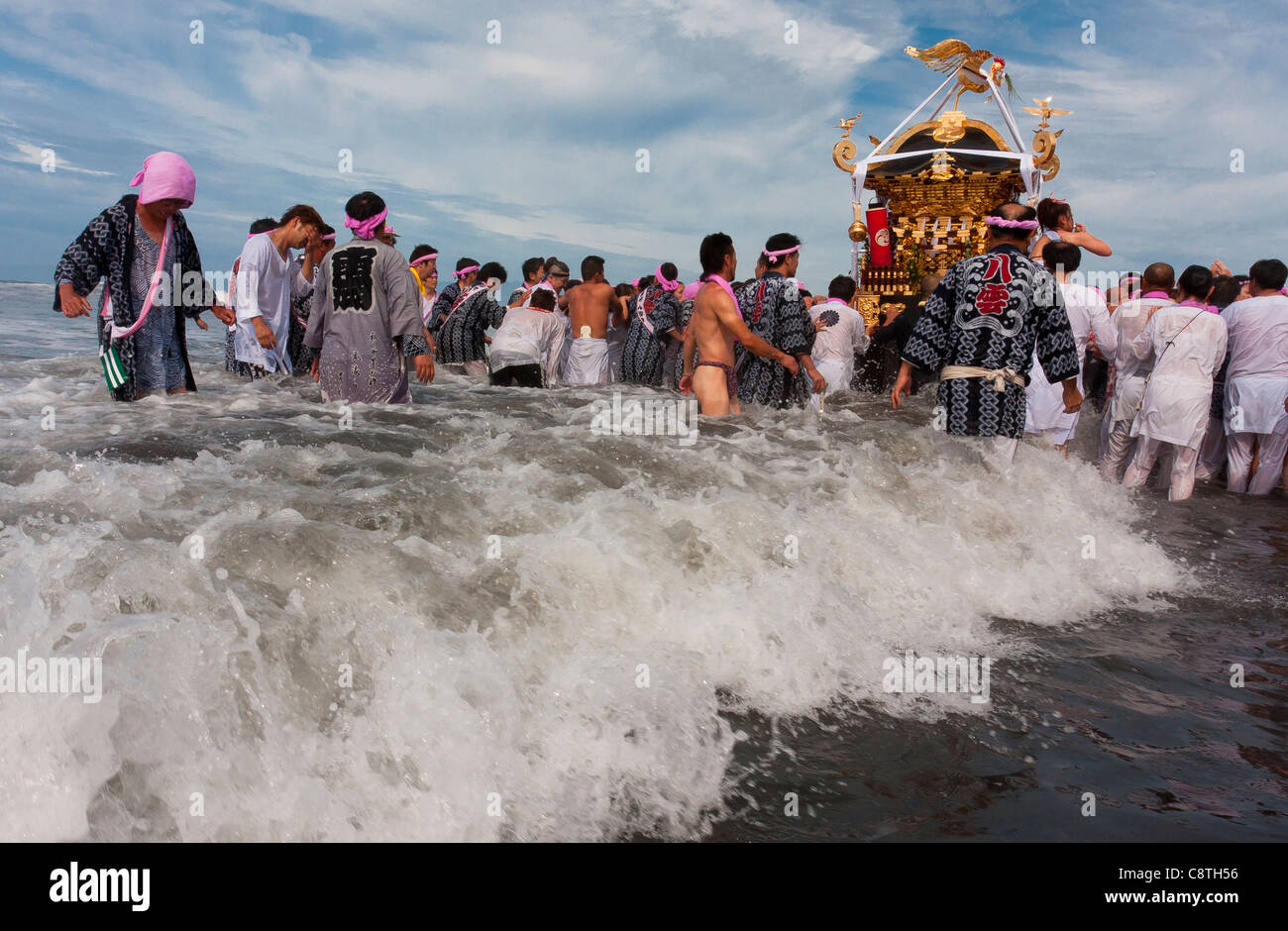 Mikoshi are carried into the sea during the Hamaorisai Matsuri that takes place on Southern Beach in Chigasaki, - Stock Image