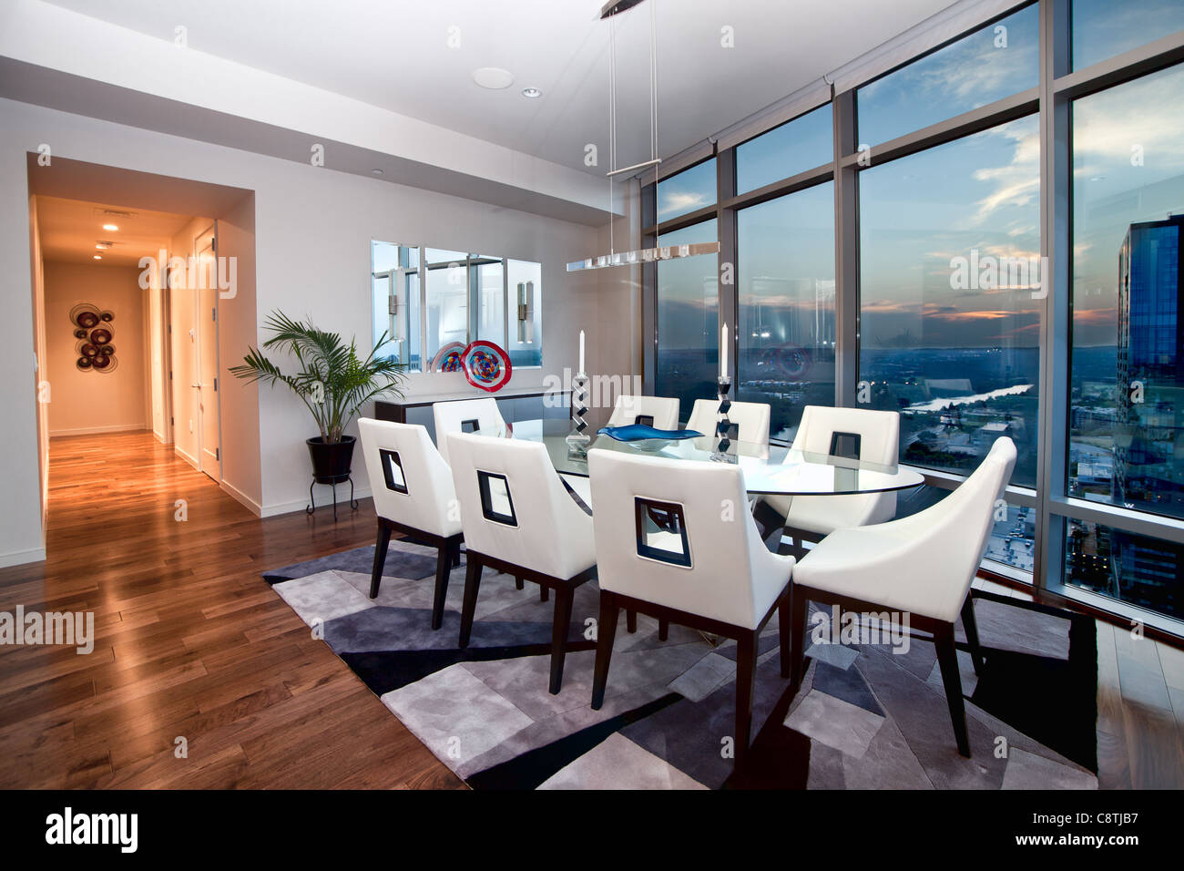 Dining Room In A Steel And Glass Luxury Condo Highrise In Austin, Texas  During Sunset