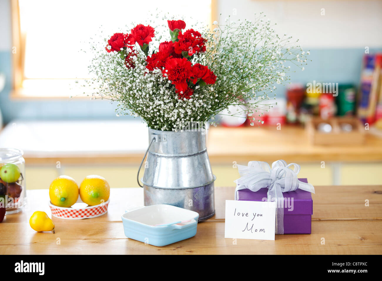 Wrapped Gift Box And Bunch Of Flower On The Kitchen Counter Stock ...