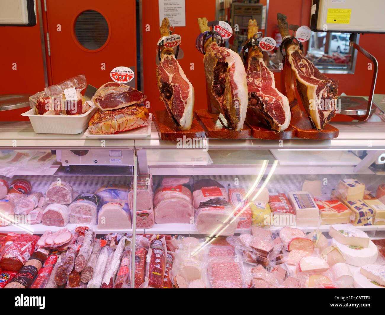 Jamon (Spanish ham) displayed in deli. Salou, Catalonia, Spain. - Stock Image