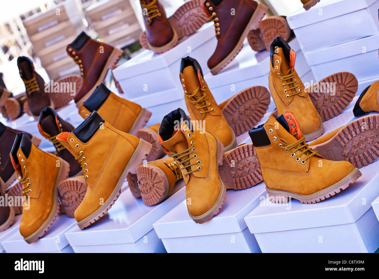 Sales of leather shoes for men on a market stall in Cannobio, Italy - Stock Image