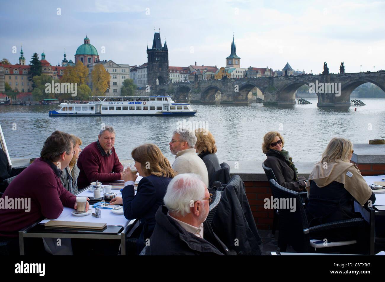 Cafe beside River Vltava in Prague in Czech Republic Stock Photo