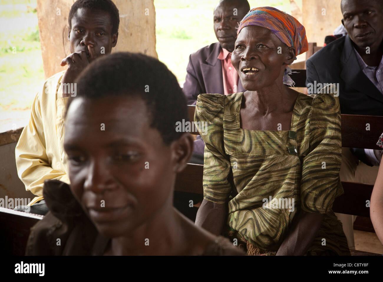 A woman attends a community meeting in Kituti village, Kibuku District, Uganda. - Stock Image