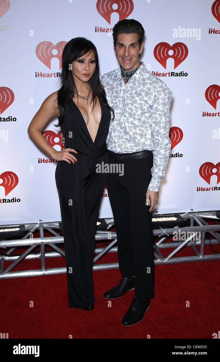 Etty Farrell, Perry Farrell at arrivals for Clear Channel Radio iHeartRadio Launch Concert - FRI, MGM Grand Garden - Stock Image