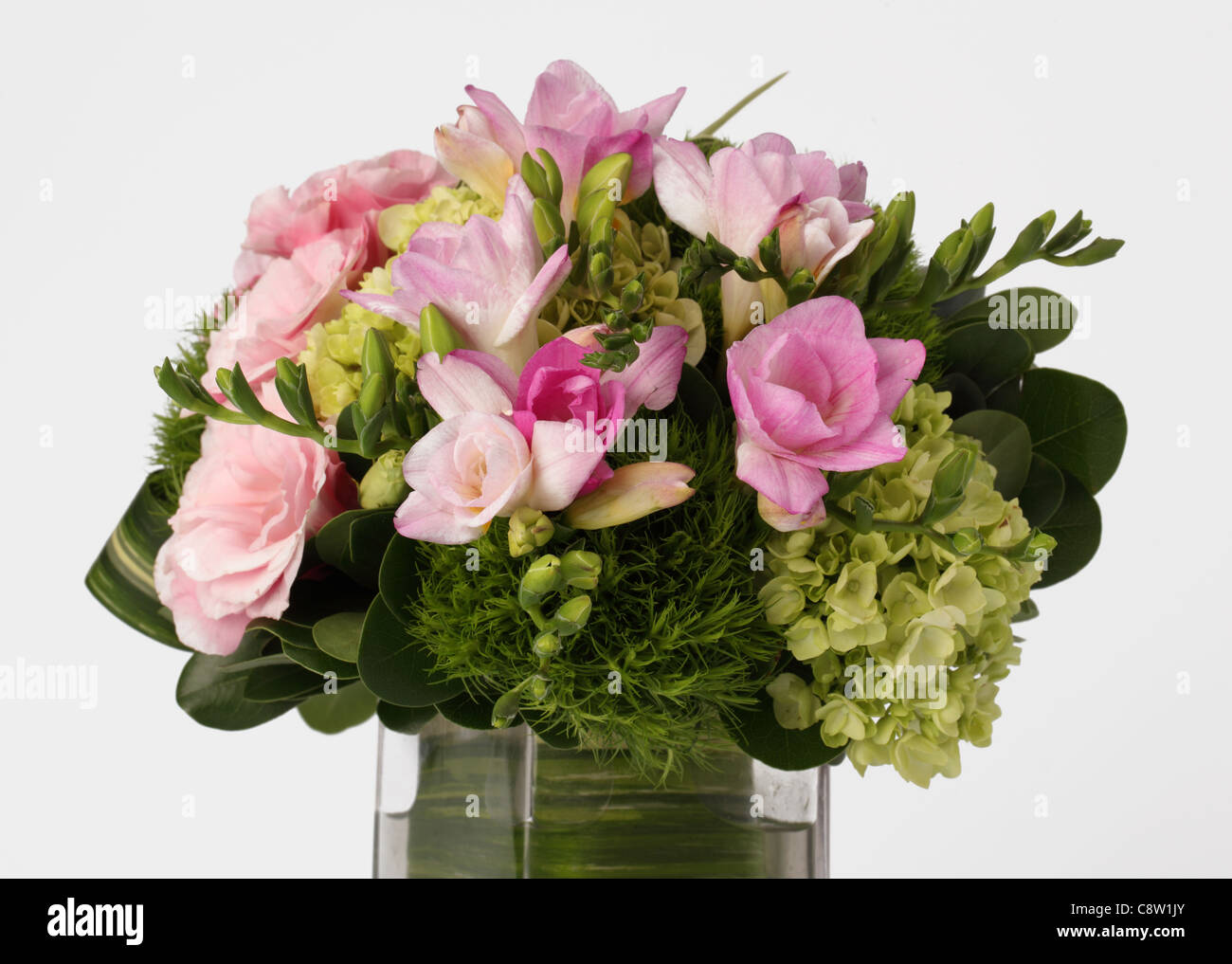 A close up of a colorful bouquet of flowers in a vase pink freesias a close up of a colorful bouquet of flowers in a vase pink freesias green hydrangeas izmirmasajfo