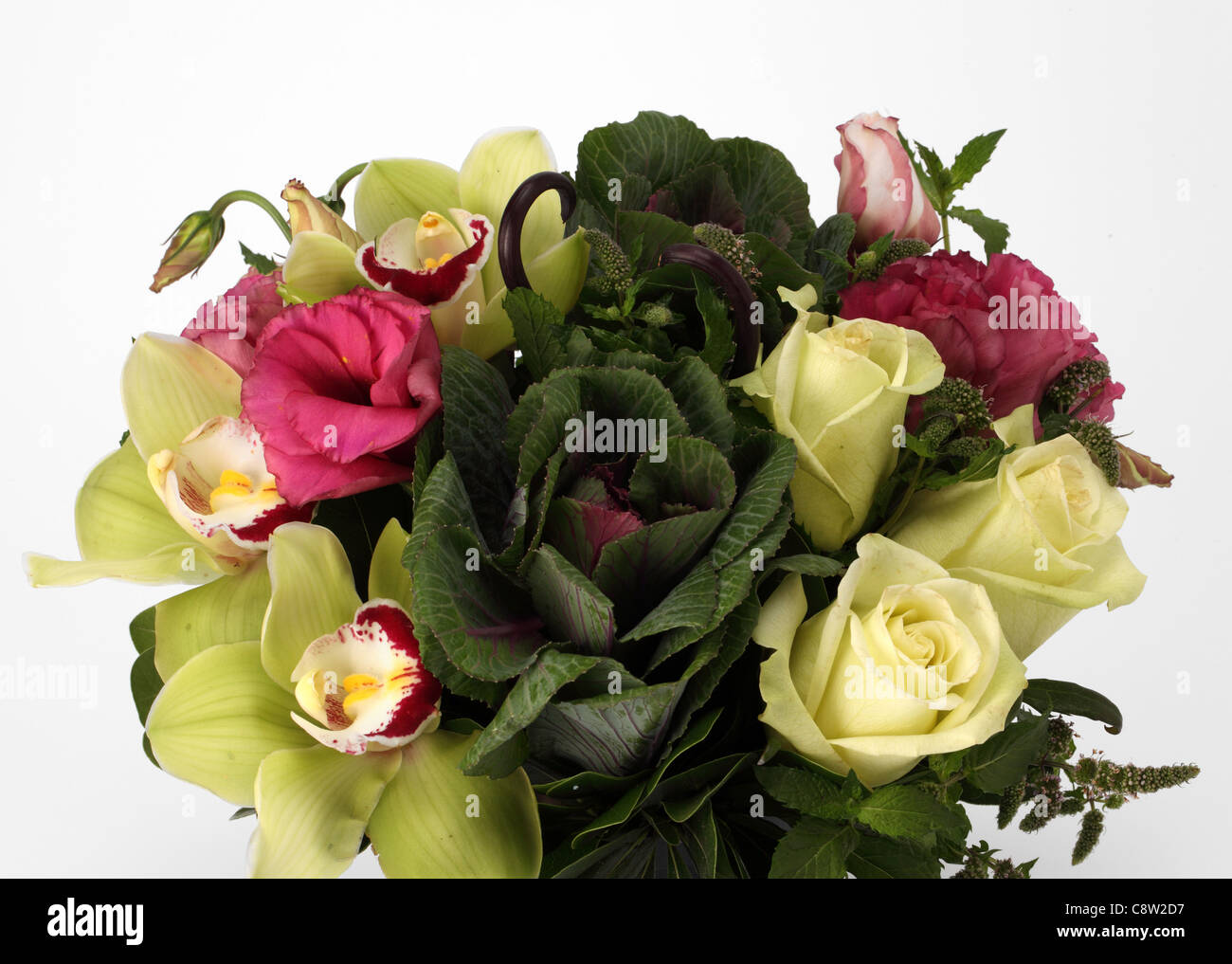 A close up of a colorful bouquet of flowers ornamental cabbage a close up of a colorful bouquet of flowers ornamental cabbage white roses cymbidium orchids pink peonies izmirmasajfo