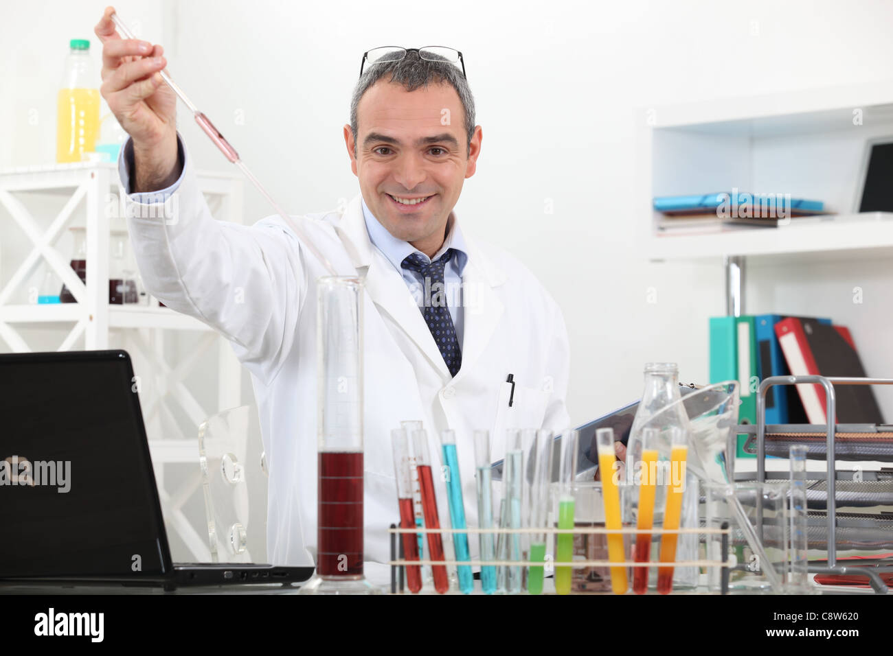 scientist making tests in the lab - Stock Image