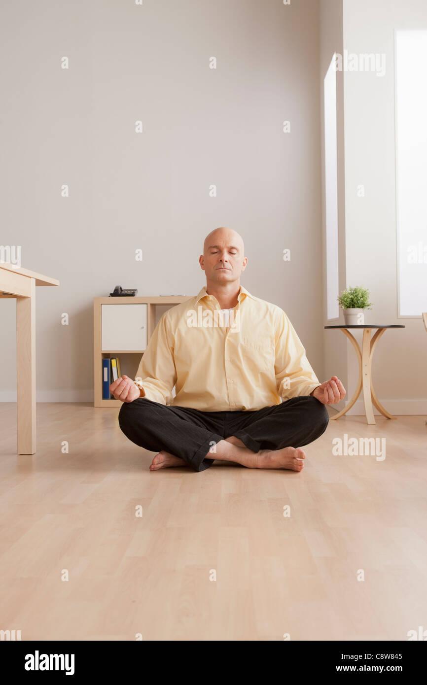 meditation businessman office. Mature Businessman Meditating In Office - Stock Image Meditation