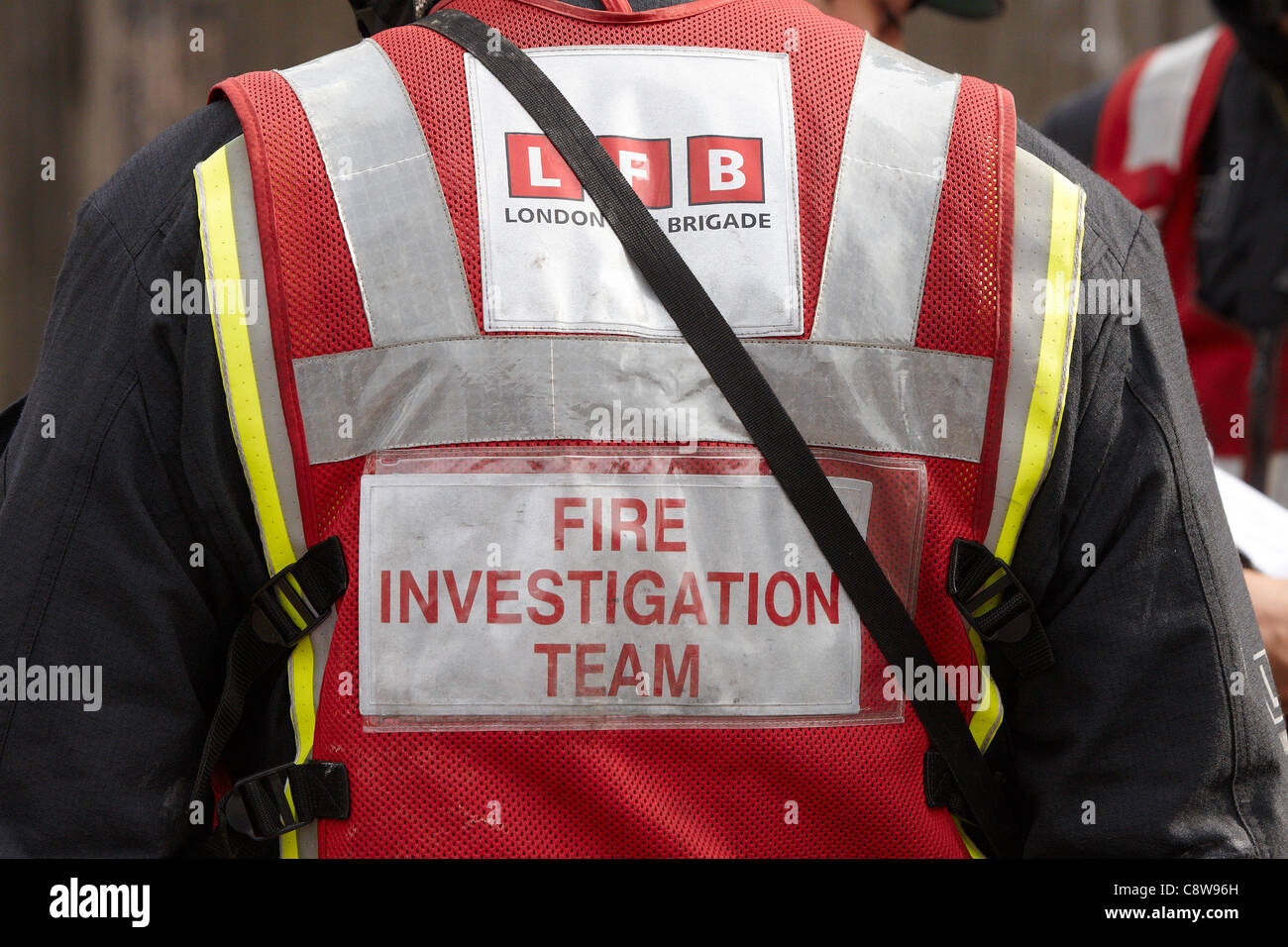 LFB fire investigation team at the scene of a house fire in Neasden that claimed the lives of 6 members of the same - Stock Image