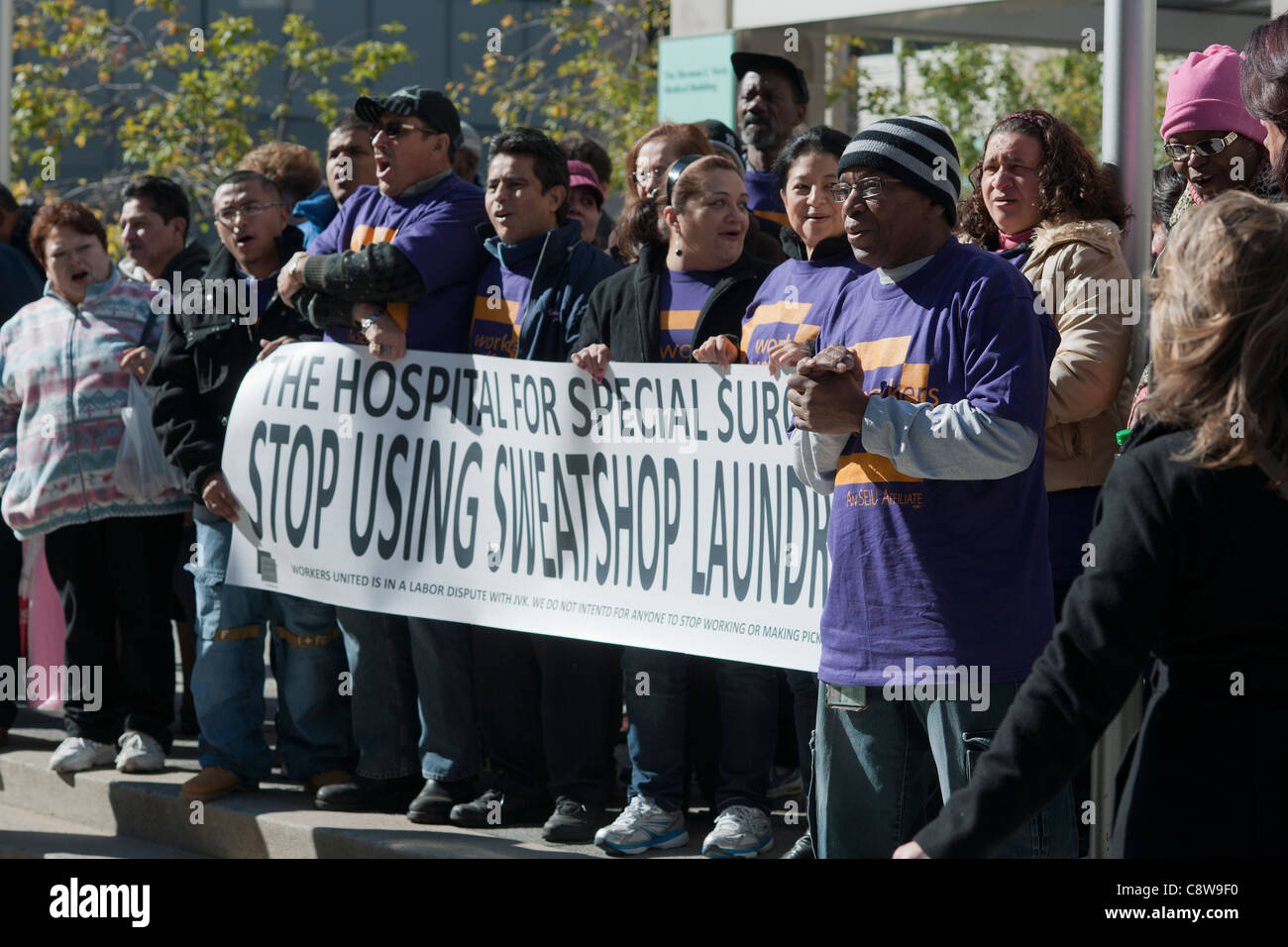 Laundry workers protest alleged sweatshop conditions by hospital subcontractor - Stock Image