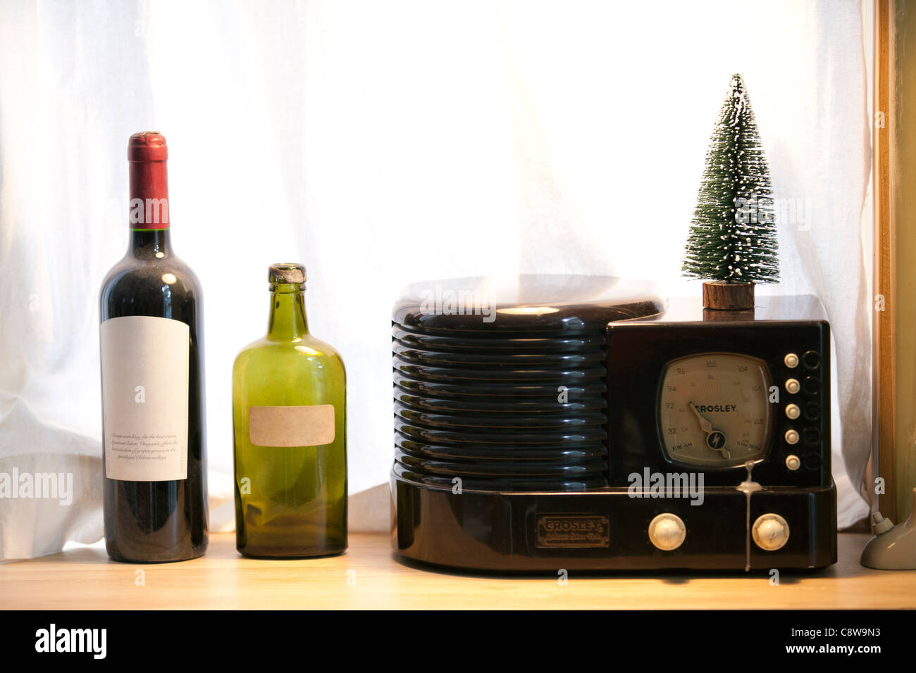 Wine Bottles, Clock, And Christmas Show Piece Stock Photo