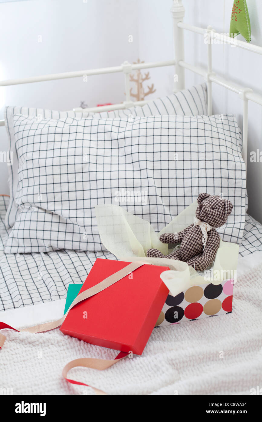 Teddy Bear In Unwrapped Gift Box - Stock Image