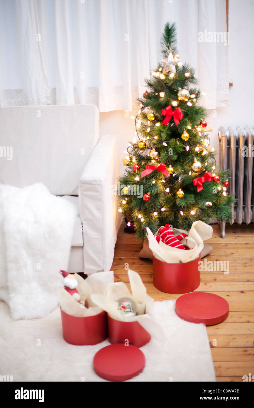 Room Interior With Unwrapped Christmas Gift Boxes And Christmas Tree - Stock Image