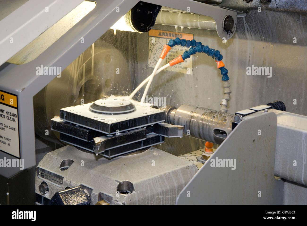 CNC lathe working on job detail - Stock Image
