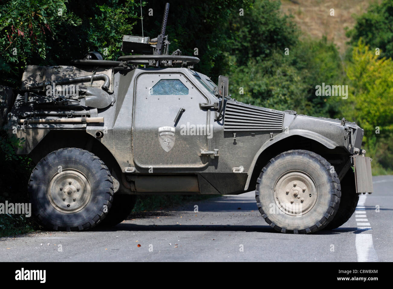 Portuguese armored reconnaissance vehicle with KFOR markings in Northern Kosovo - Stock Image