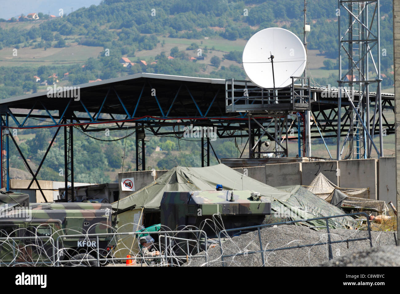US Army camp in northern Kosovo, surrounded by barbed wire - Stock Image
