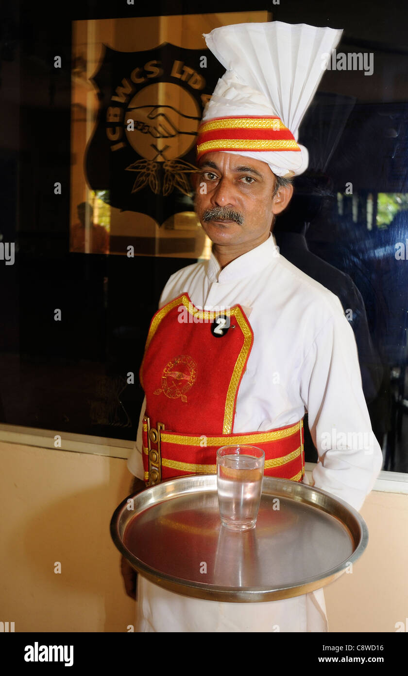 Tea Waiter Wearing The Distinctive Uniform Of Starched Uniform And Stock Photo Alamy
