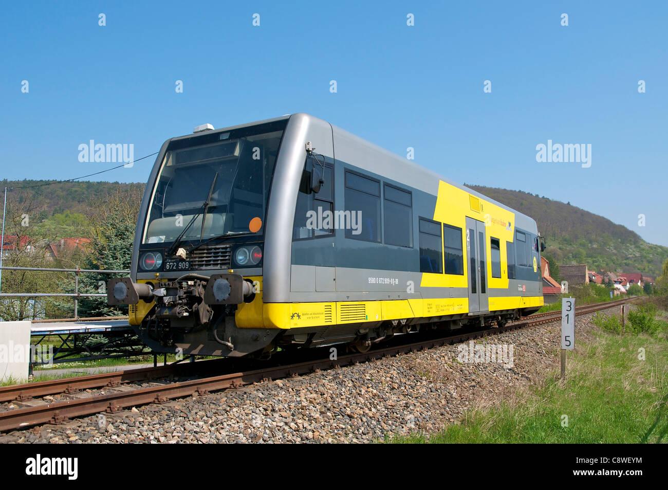 Small train called 'Burgenlandbahn' in the Unstrut valley in Wangen. - Stock Image