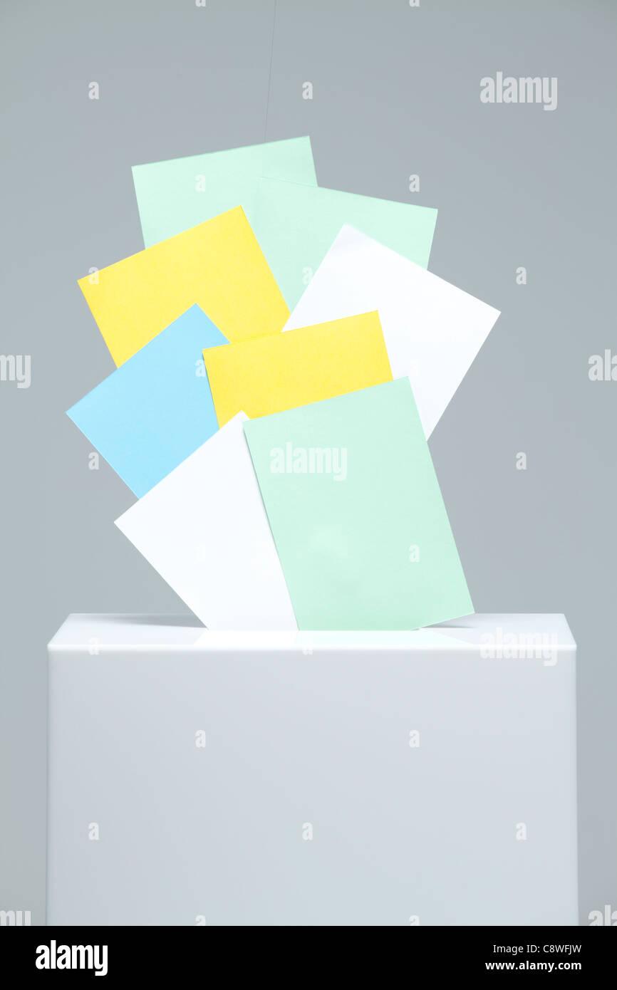 Ballots Stuffed In Ballot Box On Desk - Stock Image