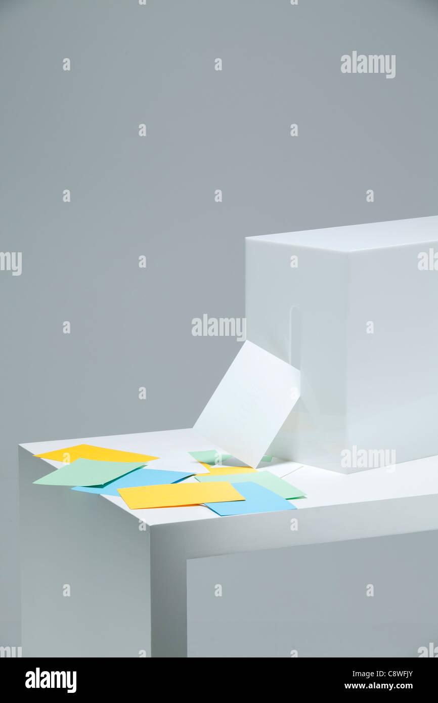 Ballots Stuffed And Ballot Box On Desk - Stock Image