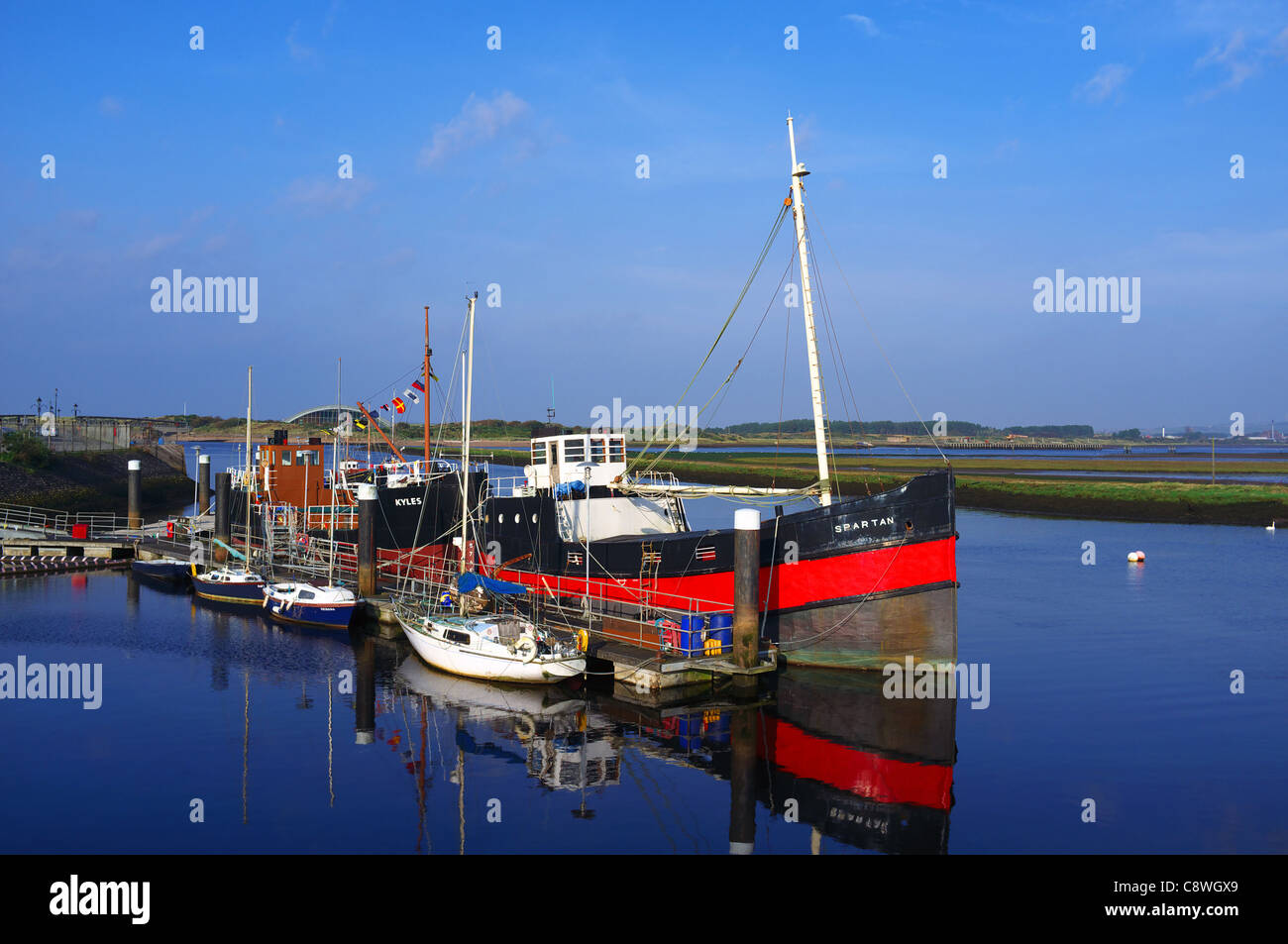"""Irvine harbour with the """"Spartan"""" tug boat, berthed and decommissioned. Ayrshire, Great Britain Stock Photo"""