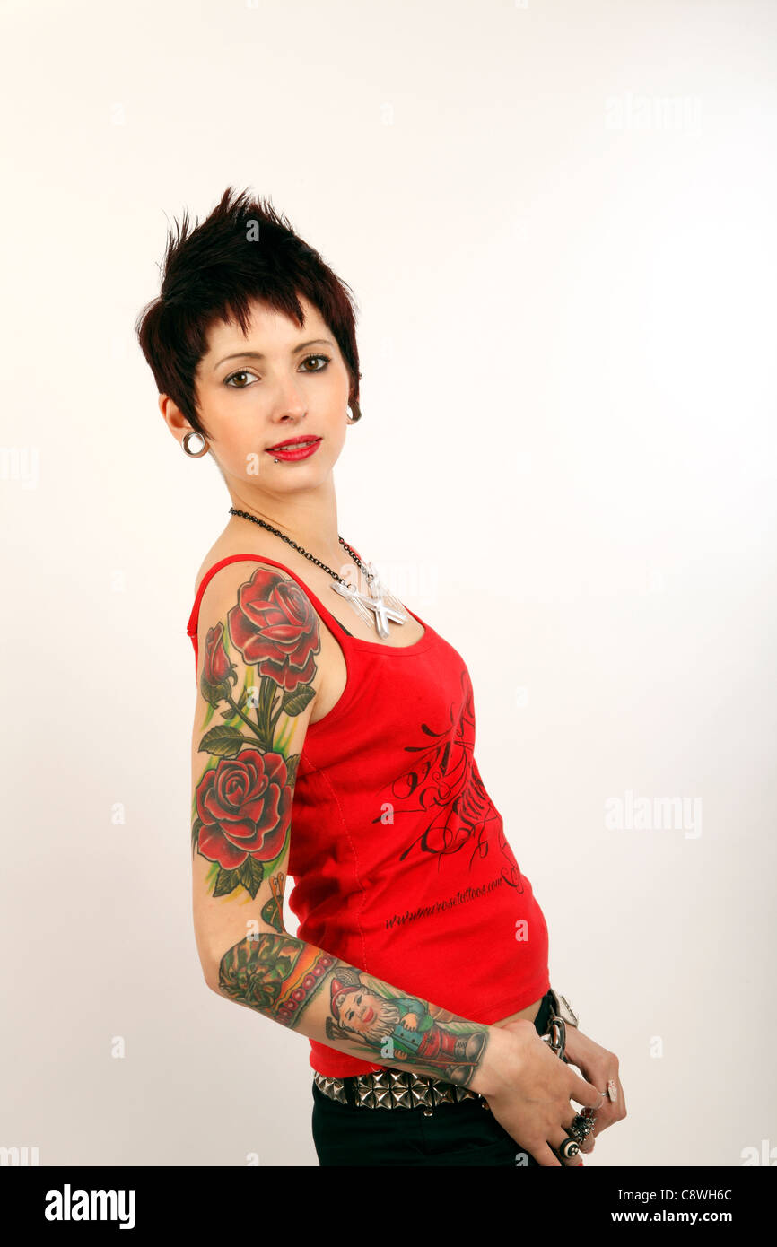 Young Woman With Tattoos On Her Arm Youth Culture Body Art Stock Photo Alamy