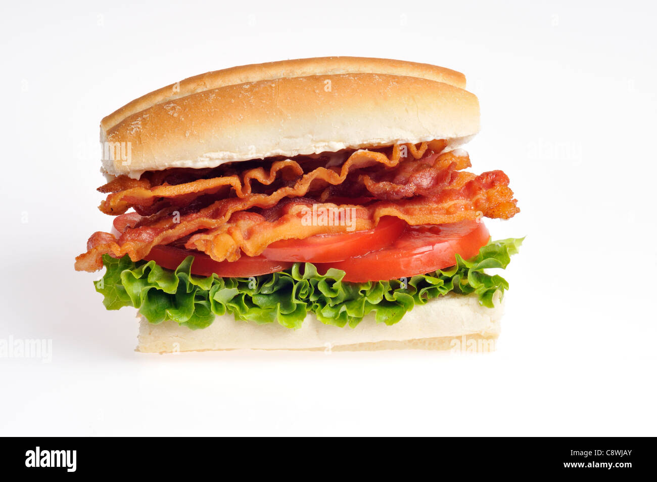 Bacon Lettuce and Tomato BLT sandwich in a roll on white background cutout. - Stock Image