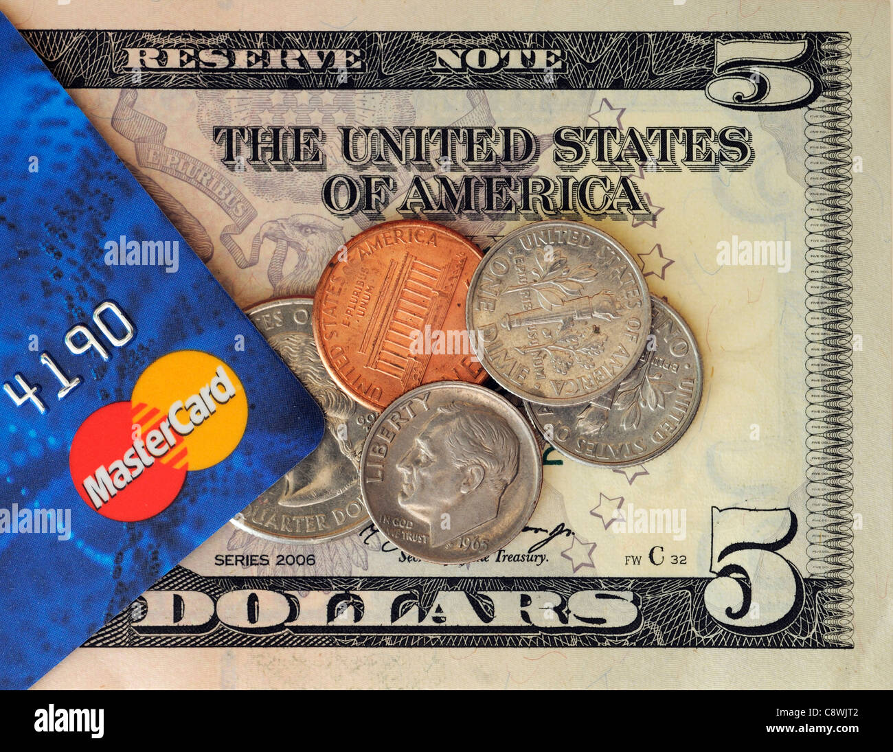 Mastercard and US dollars - Stock Image