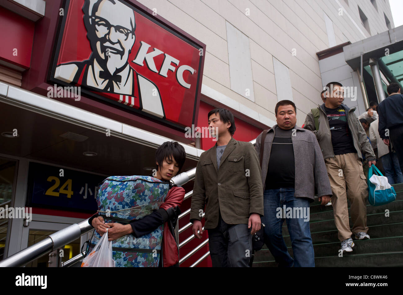 People walk past a KFC in Beijing, China. 31-Oct-2011 - Stock Image