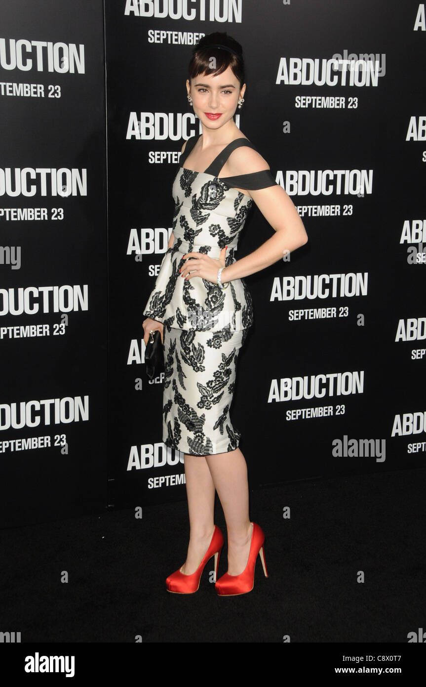 ac7beb5d6c Lily Collins (wearing a dress by Marc Jacobs and Brian Atwood shoes) at  arrivals
