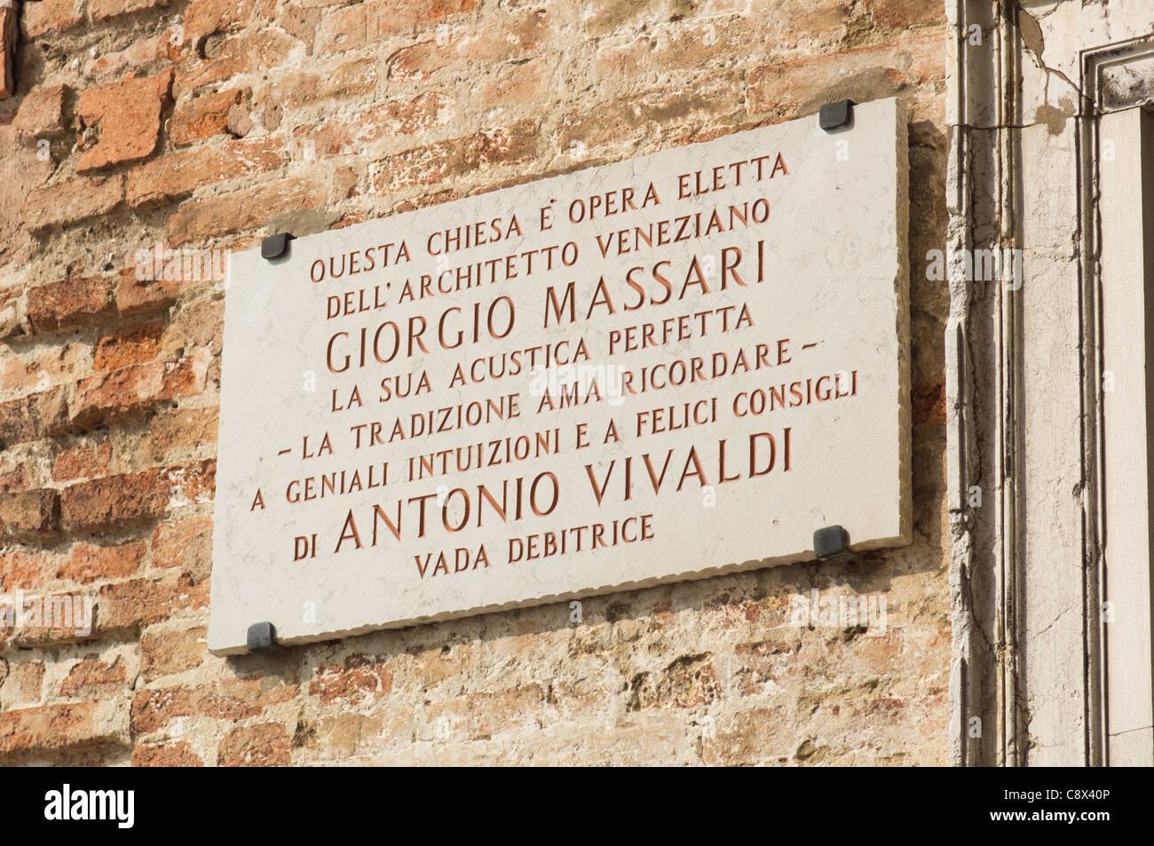 Venice plaque on the Pieta church (music venue) recording Massari's architectural work inspired by Vivaldi for - Stock Image