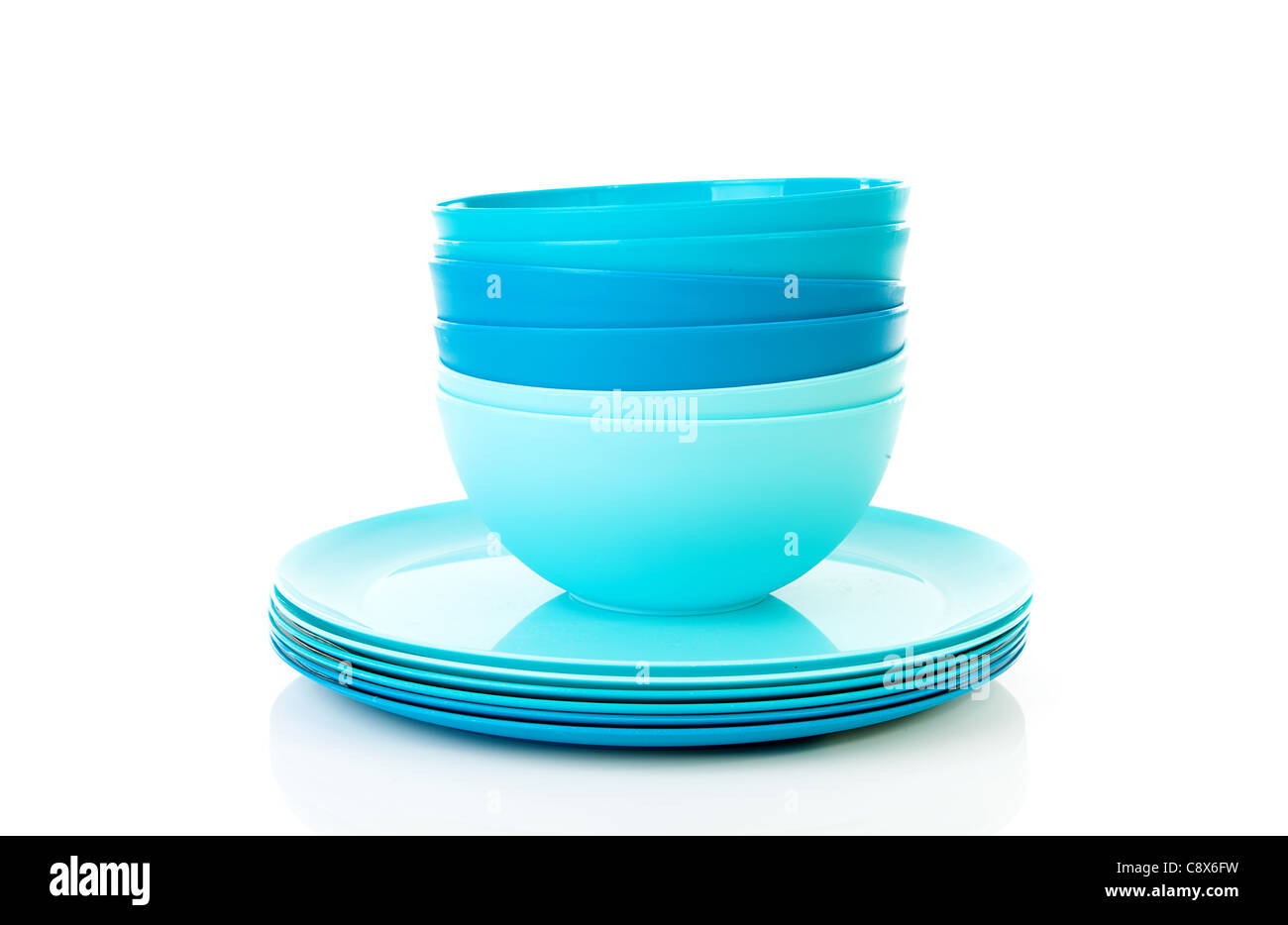 Pile of blue plastic plates and bowls over white background  sc 1 st  Alamy & Pile of blue plastic plates and bowls over white background Stock ...