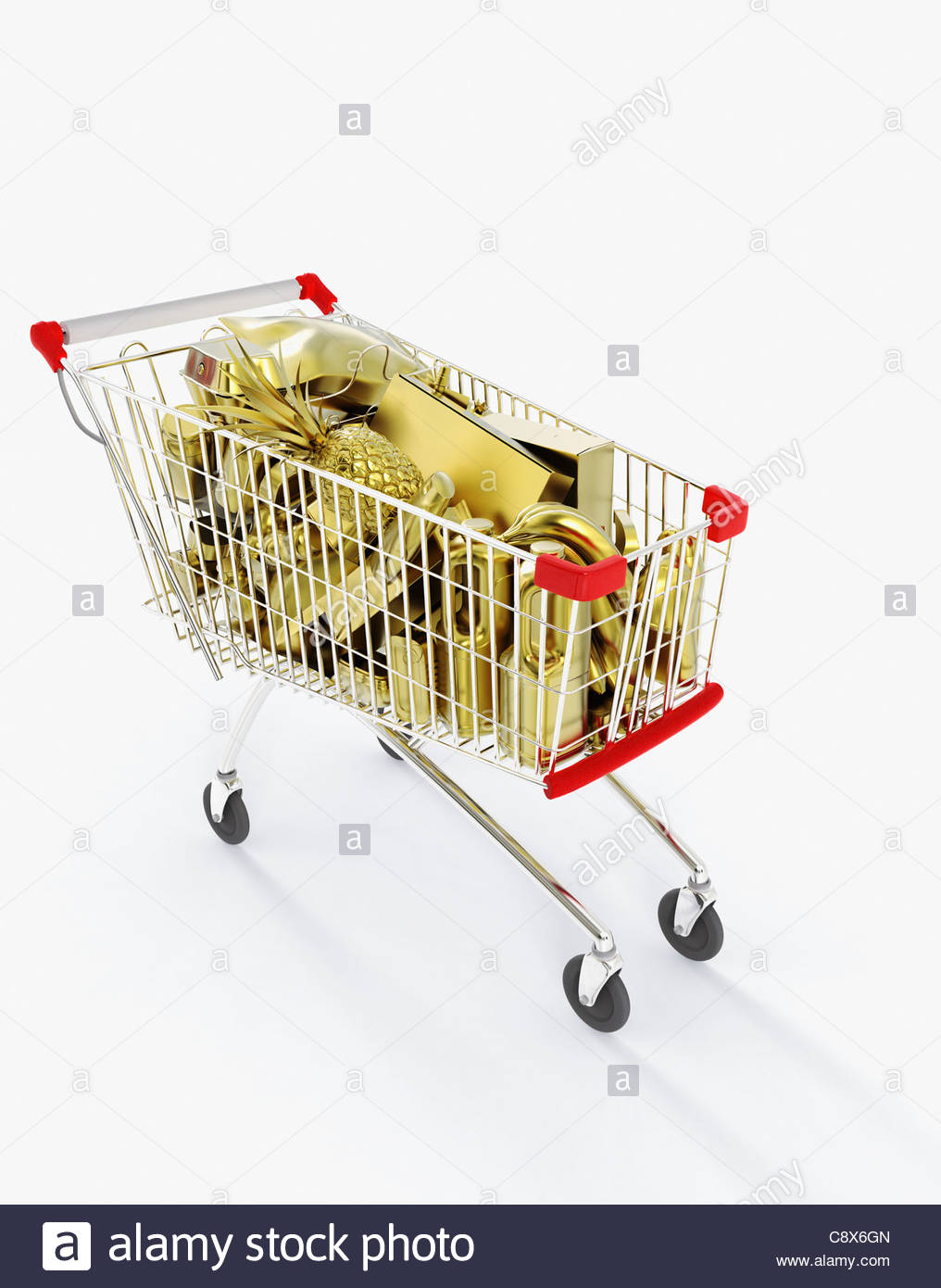 Shopping cart full of gold groceries - Stock Image
