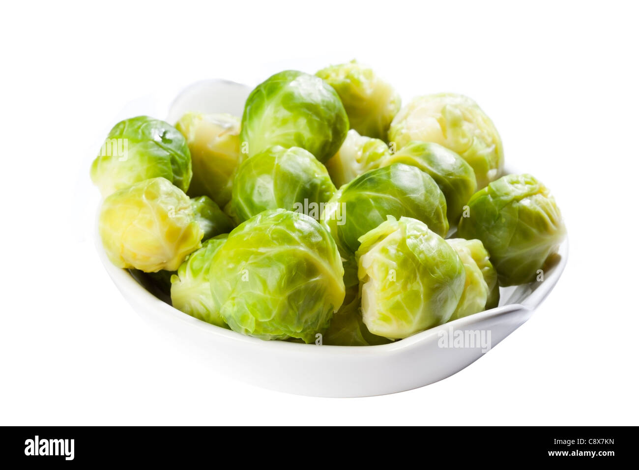 cooked brussels sprouts in bowl - Stock Image
