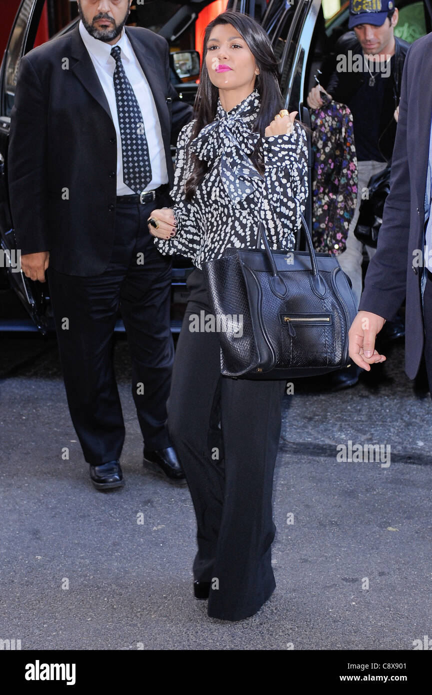b2fef2997d Kourtney Kardashian carrying Celine bag enters her Midtown Manhattan hotel  out about CELEBRITY CANDIDS - THU New York NY
