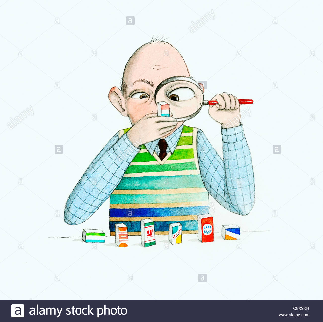 Older man reading labels with magnifying glass - Stock Image