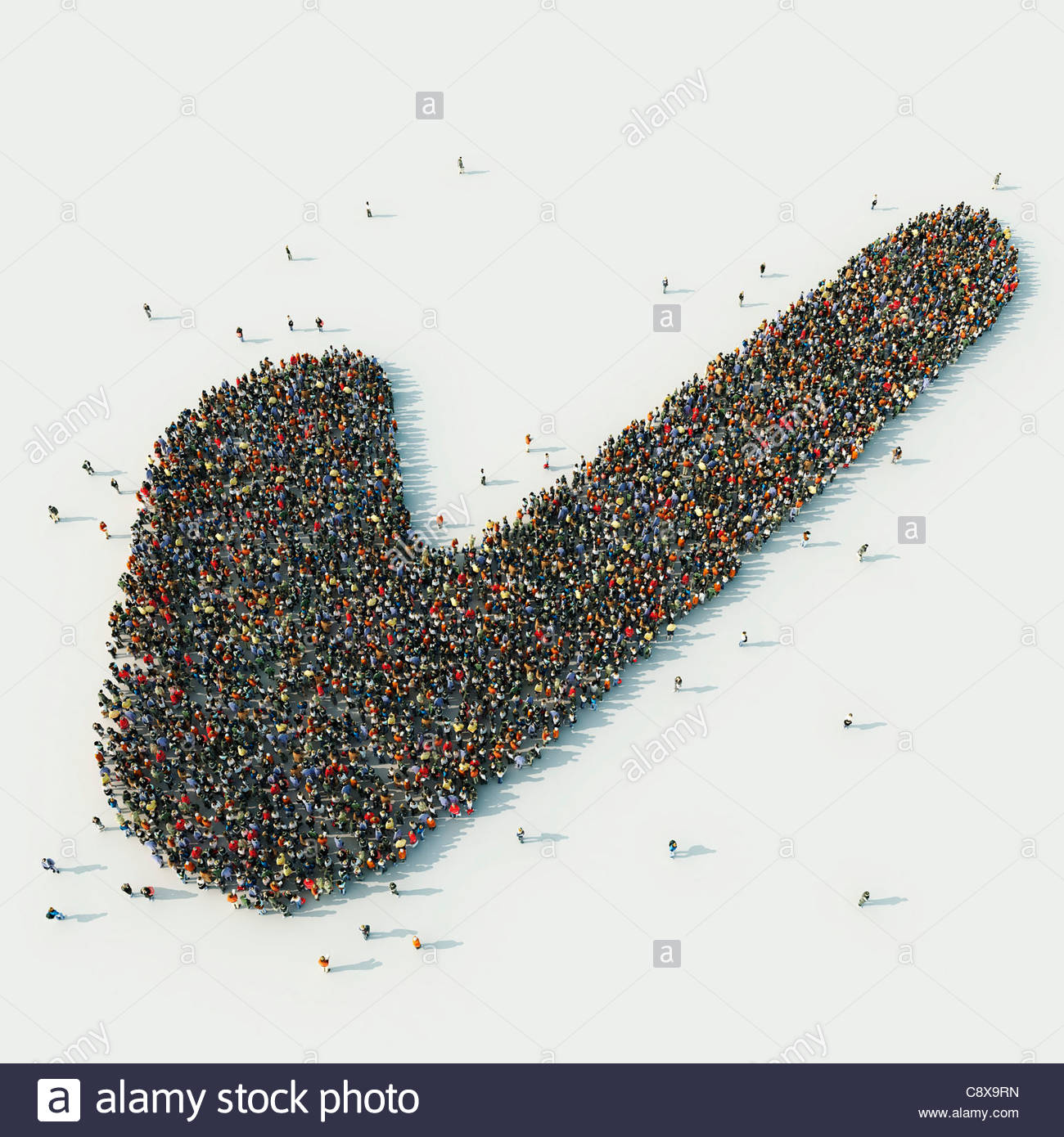 Aerial view of crowd of people arranged in check mark - Stock Image