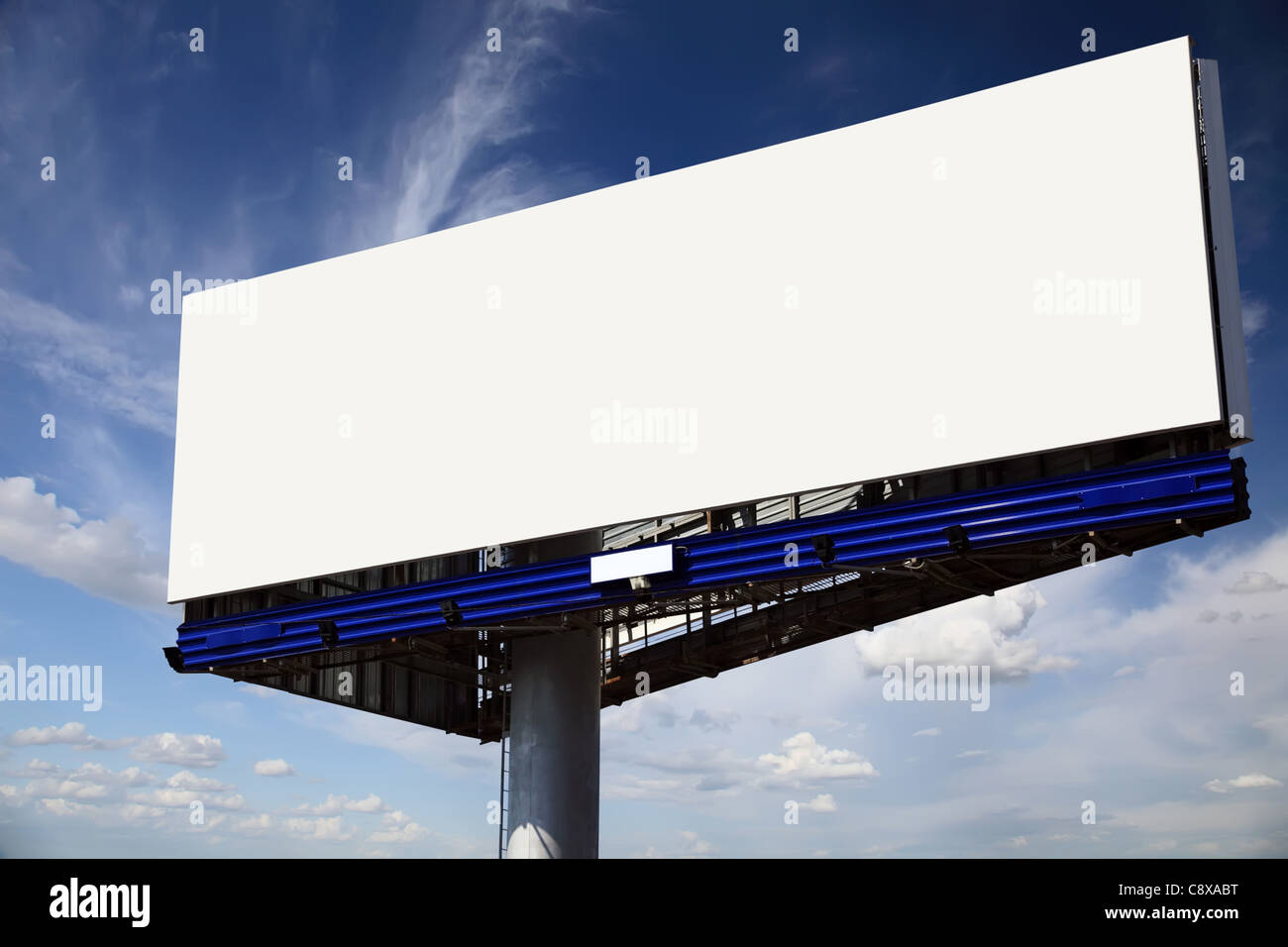 Big blank billboard with copyspace on a blue sky background. - Stock Image