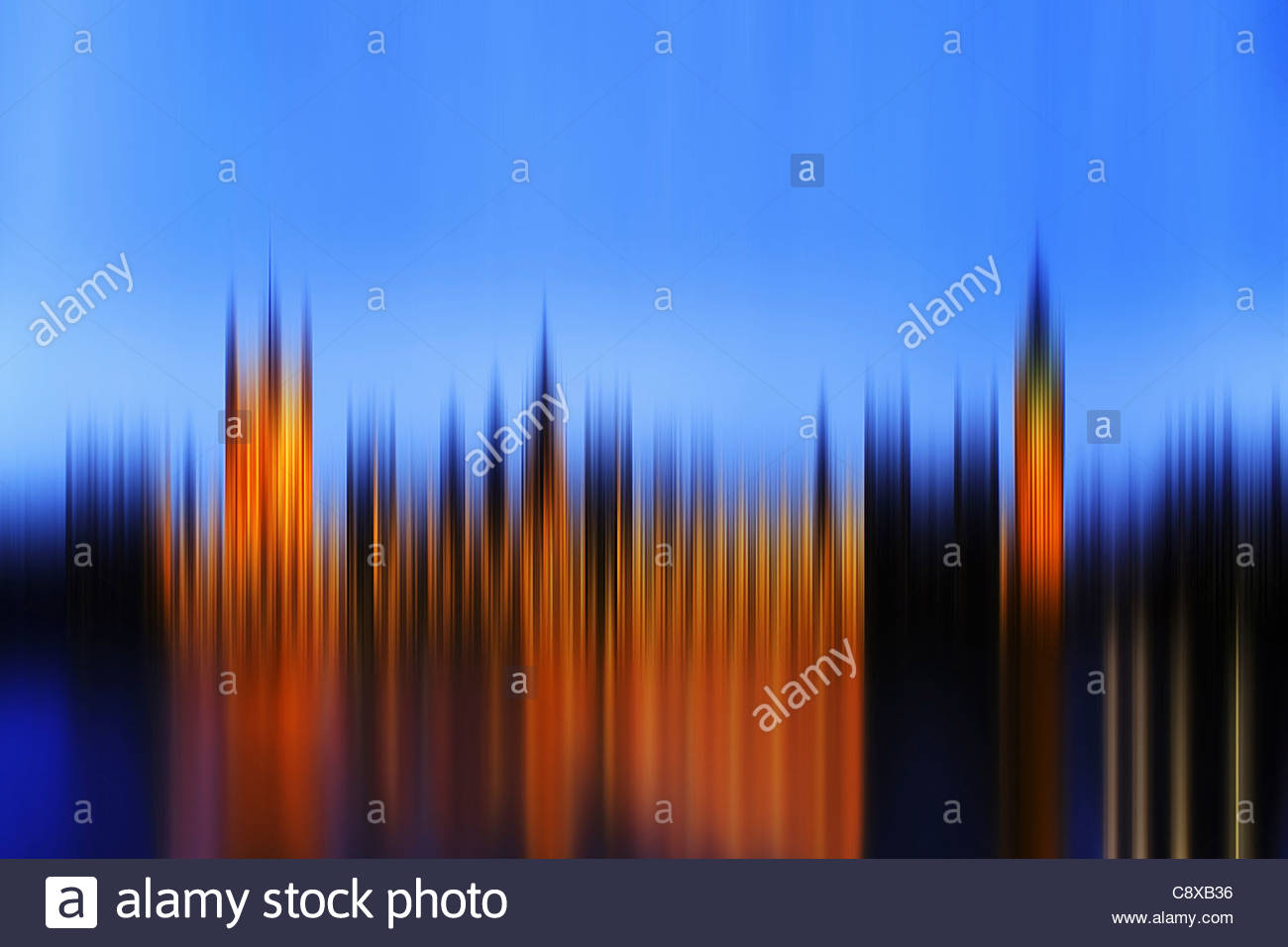 Blurred view of cityscape at night - Stock Image