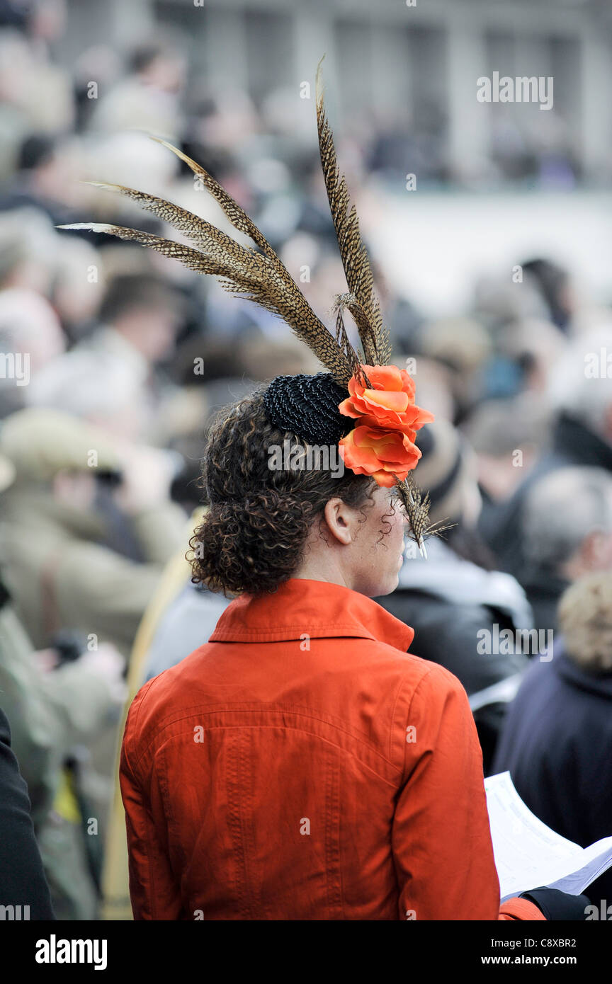 Woman wearing a hat with feathers at Cheltenham Horse racing - Stock Image